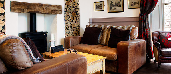 Couches at fireplace Romneys Kendal